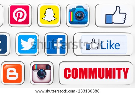 SIMFEROPOL, RUSSIA - NOVEMBER 25, 2014: Popular logotypes of social networking applications printed on sticker and placed on a buttons of keyboard. Incl.: facebook, like, instagram, twitter and other