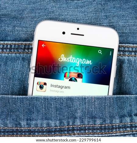 SIMFEROPOL, RUSSIA - NOVEMBER 11, 2014: Silver Apple iphone 6 in jeans pocket displaying Instagram application. Instagram is an online mobile photo-sharing, video-sharing and social networking service - stock photo