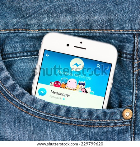 SIMFEROPOL, RUSSIA - NOVEMBER 11, 2014: Silver Apple iphone 6 in pocket displaying facebook messenger app. Facebook Messenger is an messaging service which provides text and voice communication - stock photo