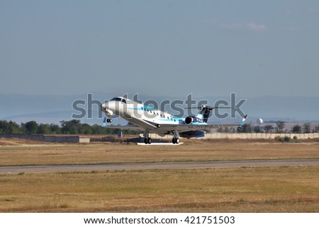 Simferopol, Ukraine - September 12, 2010: Embraer EMB-135BJ business jet is taking off from the runway in the evening