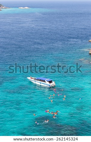 SIMILAN ISLAND, THAILAND - MARCH 6 : Group of people snorkelling in the sea at Similan island on MARCH 6, 2015 Similan island, Phang Nga, Thailand