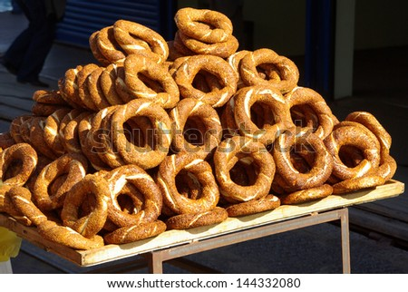 Simit bread rings for sale from pavement street vendor stall in Istanbul - stock photo