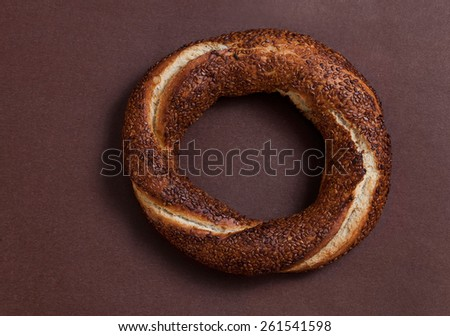 Simit (Turkish bagel) on brown background - stock photo