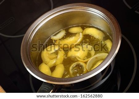 Simmer lemon peel into syrup. Candied Lemon Zest Cooking. Series. - stock photo