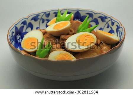 Simmering of chicken, carrot, burdock and boiled egg. Snow pea is added to a color scheme. - stock photo