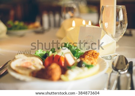 Simple and elegant restaurant table of food. Catering services background with healthy food. Wedding appetizer table. - stock photo