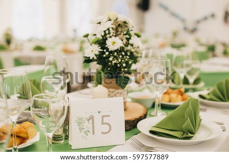 Simple and elegant wedding or festive table setting. Green and beach colors. & Simple Elegant Wedding Festive Table Setting Stock Photo 597577889 ...