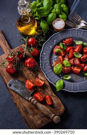 Simple and healthy dish, chopped cherry tomato and fresh basil - stock photo