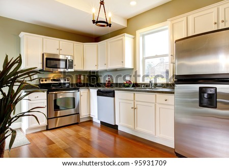 Simple and small new green kitchen. - stock photo
