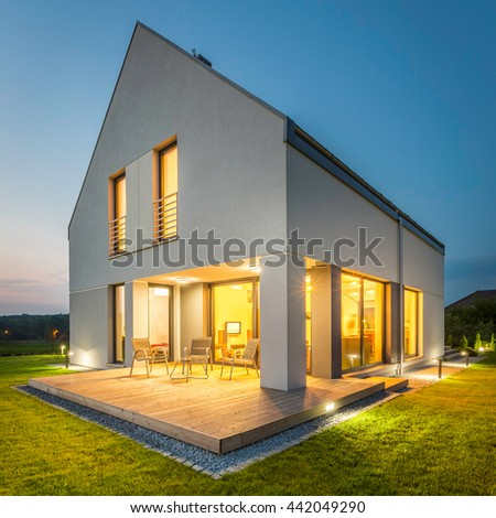 Simple And Stylish Home With Wide Lawn And Decorative Outdoor Lights,  External View