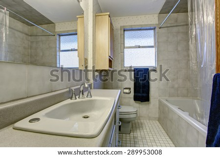 Simple bathroom with tile floors and a window.