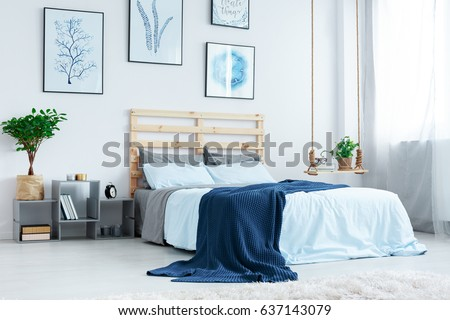Attractive Simple Bedroom With Double Bed, Blue Bedding, Posters And Window
