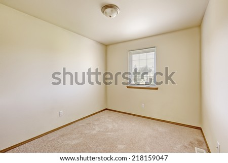 Simple bright ivory empty room with light brown carpet floor