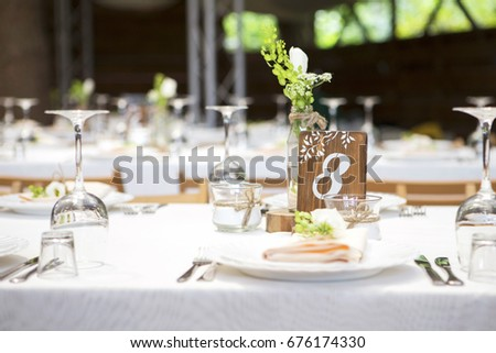 Simple but luxury rich table setting for a wedding celebration in nice cozy restaurant. Wineglasses & Simple Luxury Rich Table Setting Wedding Stock Photo 676174330 ...