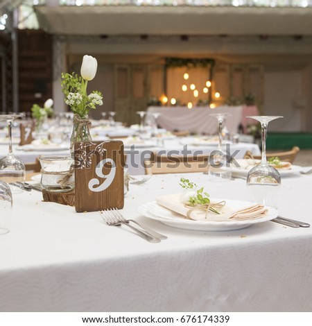 Simple but luxury rich table setting for a wedding celebration in nice cozy restaurant. Wineglasses & Simple Luxury Rich Table Setting Wedding Stock Photo (Royalty Free ...