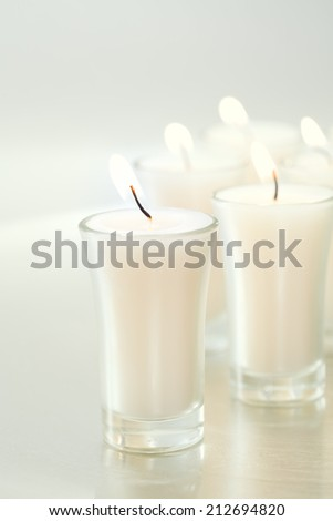 Simple candles.   - stock photo