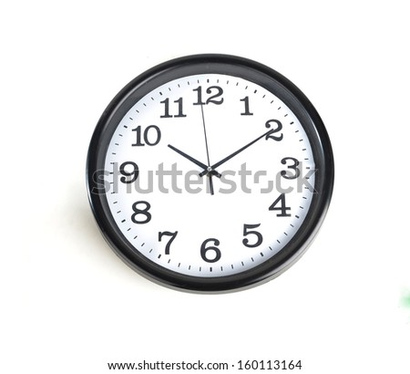 Simple classic black and white round wall clock isolated on white