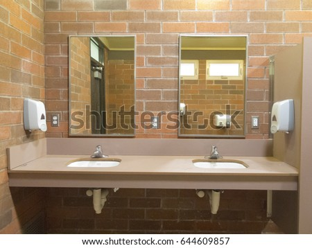 Simple clean public washroom with sinks and mirrors on raw brick wall. Washroom Stock Images  Royalty Free Images   Vectors   Shutterstock