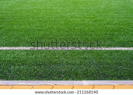 Simple clear soccer field from the side - stock photo