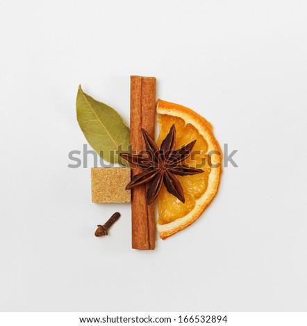 Simple creative design decorative arrangement of mulled wine / punch / tea condiments / spices - stock photo