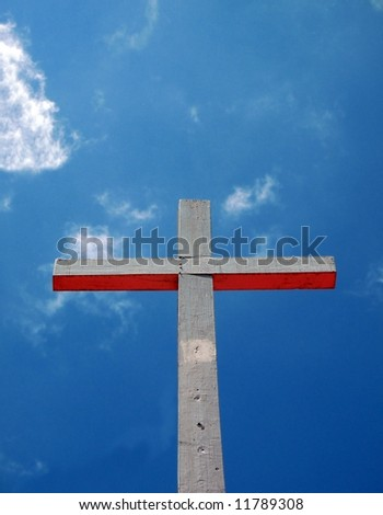 Simple Cross -- seen against a beautiful sky -- concept of Heaven - stock photo