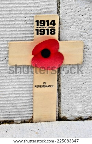 Simple cross with poppy commemorating the centennial of World War I