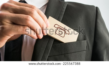 Simple Customer Support Concept Design - Close up Businessman Putting Small Piece Wooden Sign, with Telephone Drawing, to His Front Business Suit Pocket. - stock photo