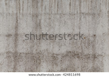 Simple dark concrete wall background with texture - stock photo