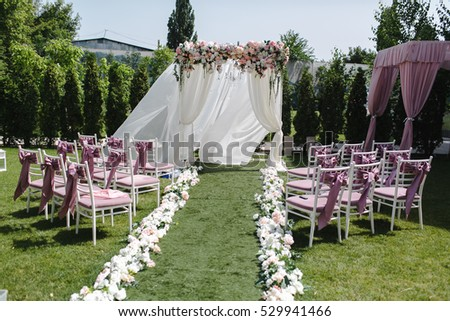 Simple decor wedding many pink white stock photo royalty free simple decor for the wedding many pink and white chairs arranged on the lawn green junglespirit Image collections