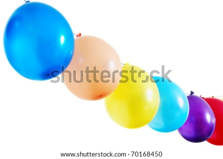 Simple diagonal line of colorful balloons on white background