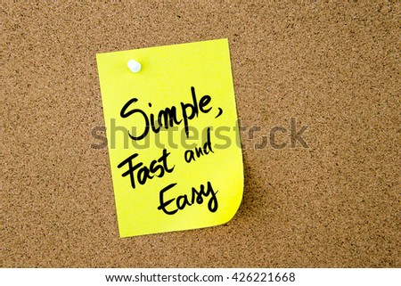 Simple, Fast and Easy written on yellow paper note pinned on cork board with white thumbtack, copy space available - stock photo