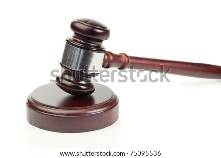 Simple gavel in action on a white background - stock photo