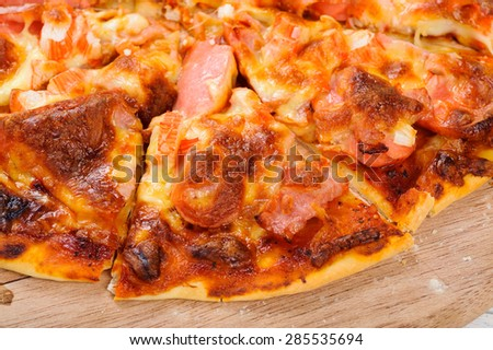 Simple home made pizza on wood plate