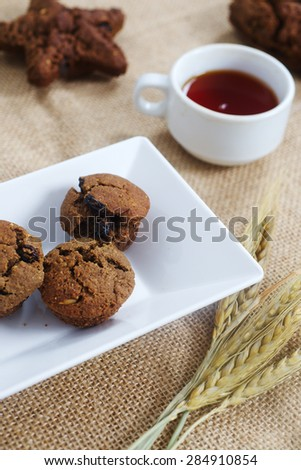 Simple homemade cakes on a table with canvas and ears of wheat