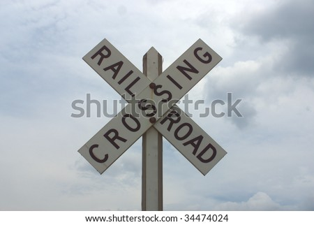 simple horizontal close-up of rail road crossing sign - stock photo