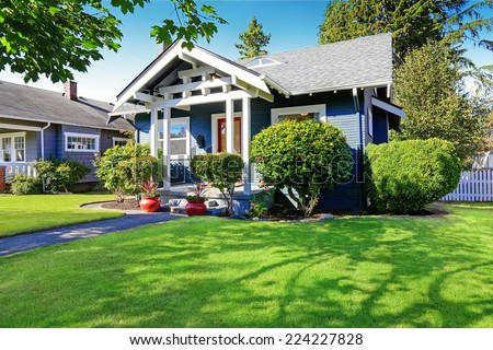 Simple house exterior with tile roof. Front porch with curb appeal - stock photo