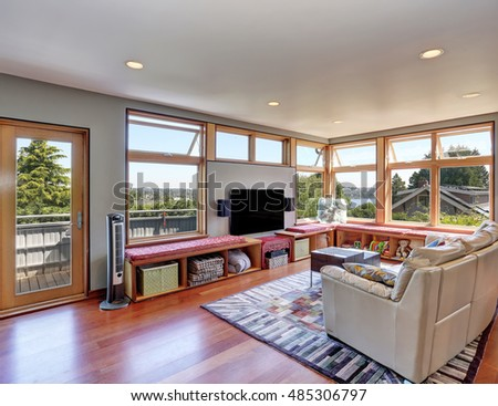 Simple interior design of shiny living room. Window benches with storage units. Northwest, USA