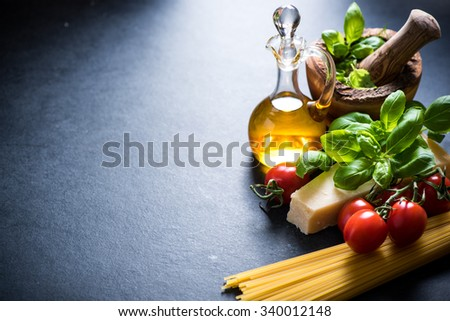Simple italian dish, spaghetti ingredients, food border background - stock photo