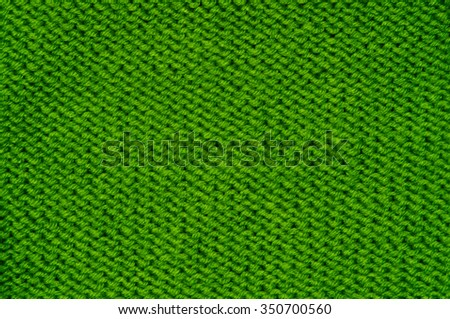 Simple knitted green background, classic pattern macro