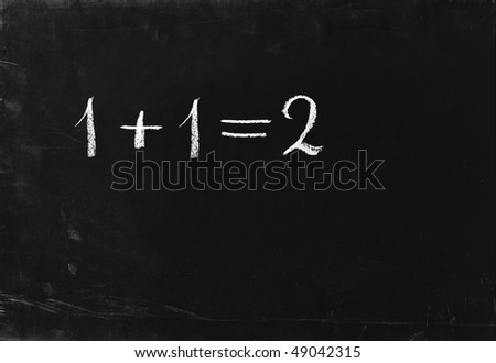 Simple math operation writing chalk on blackboard. 1+1=2
