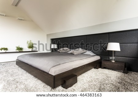 Japanese Design Bedroom. Simple new design bedroom with japanese style bed  carpet and upholstered wall New Design Bedroom Japanese Style Stock Photo 464383163