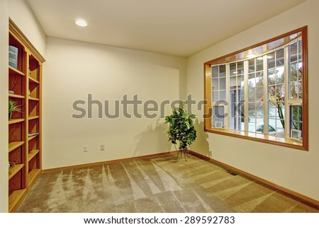 Simple office room with carpet and windows.