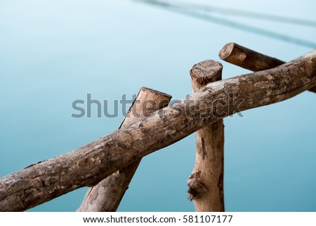 simple old wood fence by the lake.