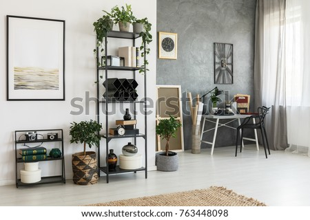 Simple Painting On White Wall In Living Room With Decorations A Shelf And Plants