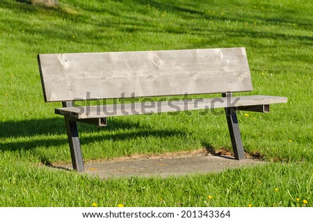 Simple park bench on early morning