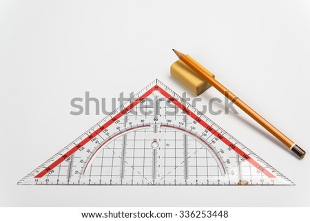 Simple pencil, eraser and ruler a triangle on a light background - stock photo
