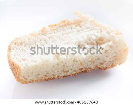 Simple piece of bread on white isolated background
