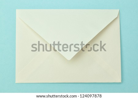Simple postal envelope on a blue background. - stock photo