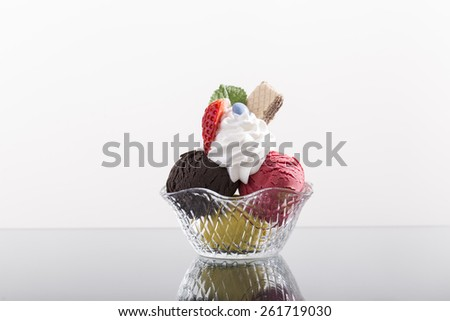 simple restaurant sundae, with whipped cream, and strawberry - stock photo