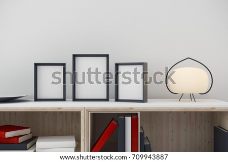 Simple room interior with items on cabinet and empty picture frames. White wall background. Close up. Decoration concept. Mock up, 3D Rendering
